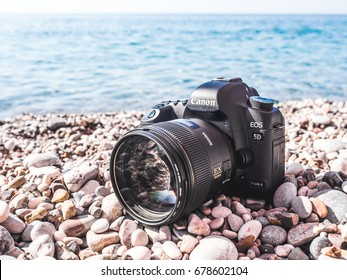 Antalya, Turkey - June 29, 2017: Canon 5D mark 2 interchangeable-lens professional dslr camera with sigma portrait lens on the beach. Dustproof. Mediterranean sea