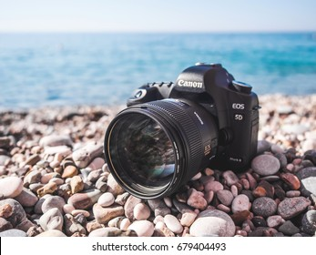 Antalya, Turkey - June 29, 2017: Prime Fast Sigma 85mm portrait lens on Canon 5D mark 2 interchangeable-lens professional dslr camera on the beach. Dustproof. Mediterranean sea