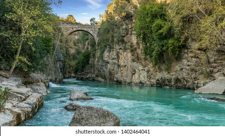 Antalya, Turkey - March 2019: Antique Oluk Bridge across Kopru Irmagi creek in Koprulu Kanyon national park in Antalya Turkey.
