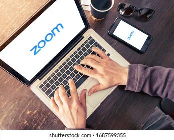 Antalya, TURKEY - March 30, 2020. Laptop and mobile phone showing Zoom Cloud Meetings app logo.
