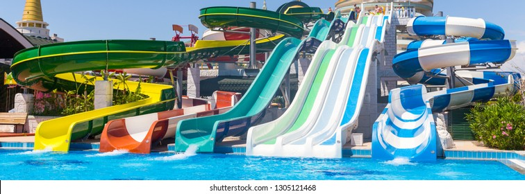 ANTALYA, TURKEY - MAY 11, 2014: Colorful waterpark tubes and a swimming pool in Delphin Imperial hotel on MAY 11, 2014 in Antalia