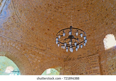 ANTALYA, TURKEY - MAY 12, 2017: The huge stone dome and chandelier of Alaaddin Mosque, also known as Yivliminare or Ulu Cami (Grand Mosque) - the notable city landmark, on May 12 in Antalya.