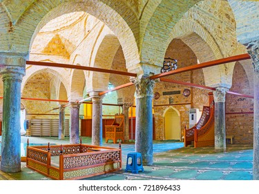 ANTALYA, TURKEY - MAY 12, 2017: Panorama of prayer hall of Alaaddin Mosque (Yivliminare or Ulu Cami), with ancient Roman columns, stone arcades, carved wooden furniture, on May 12 in Antalya.