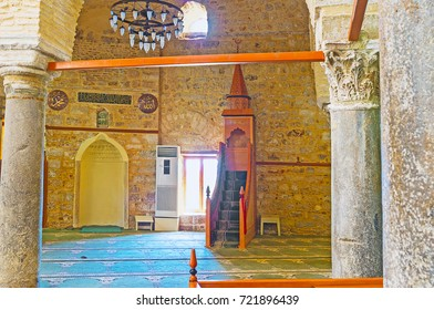 ANTALYA, TURKEY - MAY 12, 2017: Interior of Alaaddin Mosque, also known as Yivliminare or Ulu Cami (Grand) with a view on minbar (pulpit) and wooden mihrab (niche in wall), on May 12 in Antalya.