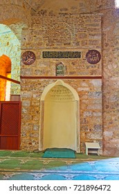 ANTALYA, TURKEY - MAY 12, 2017: Mihrab in Alaaddin Mosque (Yivliminare or Ulu Cami), niche in wall, indicating direction of Kaaba in Mecca, that Muslims should face when praying, on May 12 in Antalya.