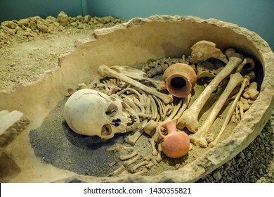 Antalya, Turkey - May 20, 2019: Burial in a jug. Antalya Museum, the exhibit of human burial in a clay jug.