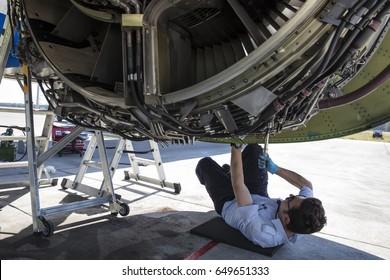 Antalya, Turkey May 28, 2017; International Antalya Airport Turkey. Aircraft mechanic repairs engine of airplane Boeing 737-800 . Airplane maintenance. Aircraft technician.