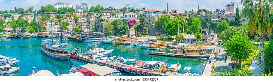 ANTALYA, TURKEY - MAY 6, 2017: Old marina is most popular tourist place, cozy cafes, luxury restaurants, green park, landmarks and fascinating trips wait the visitors in port, on May 6 in Antalya.