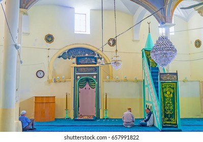 ANTALYA, TURKEY - MAY 6, 2017: The prayer hall of Aladdin Mosque in Kaleici with old mihrab and minbar, decorated with arabic calligraphy, on May 6 in Antalya.