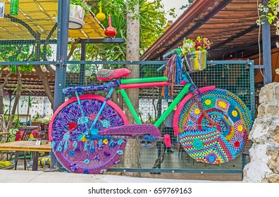 ANTALYA, TURKEY - MAY 6, 2017: The bicycle in knitted cover is the perfect street decoration, also serving as the flower pot, on May 6 in Antalya.
