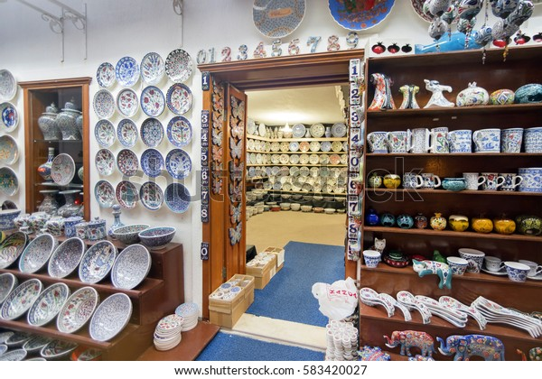 Antalya, Turkey, May 8, 2016: East souvenir shop with a lot of beautiful plates with ornament