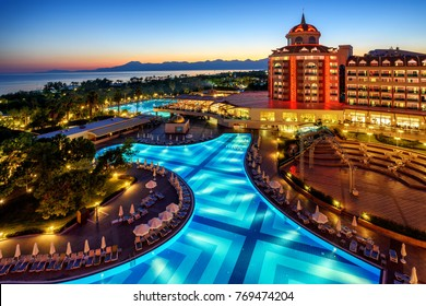 Antalya, Turkey - October 15, 2017: Luxurious all inclusive Delphin Be Grand hotel on mediterranean turkish Riviera coast illuminated on sunset. Antalya, Turkey, on October 15, 2017.
