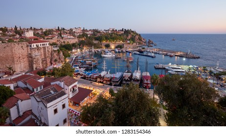ANTALYA, TURKEY - OCTOBER 5, 2017: Yachts and trip boats in the port of Antalya. The port is surrounded by city walls erected in Byzantine era