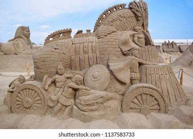 ANTALYA, TURKEY - SEPTEMBER 28, 2017 : Lara Beach, Sandland Sand Sculpture Festival. View of big sand sculpture of mythological characters - the Wooden Horse of Troy