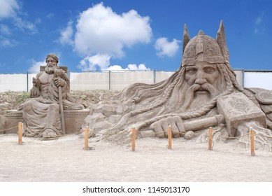 ANTALYA, TURKEY - SEPTEMBER 28, 2017 : Lara Beach, Sandland Sand Sculpture Festival. View of big sand sculpture of mythological characters - 	Zeus statue and Thor.