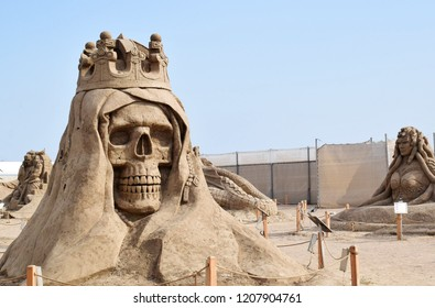 ANTALYA, TURKEY - SEPTEMBER 28, 2017 : Lara Beach, Sandland Sand Sculpture Festival. View of big sand sculpture of mythological characters. The skull is a symbol of death and danger, as well.