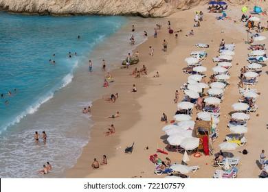 ANTALYA,TURKEY - AUGUST 31 2017: People enjoying sun and sea at the turquoise sea and sandy beach of Kaputas, Kas, Antalya, Turkey.