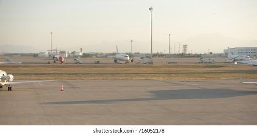 Antalya;Turkey-August 11; 2017:Antalya Airport, Turkey, early in the morning. Planes on parking