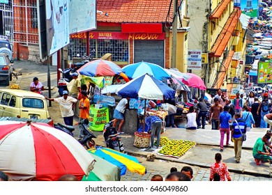 ANTANANARIVO, MADAGASCAR - CIRCA OCTOBER 2016: Vendors on a staircase leading to Analakely Market