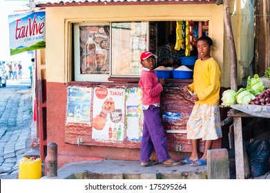 ANTANANARIVO, MADAGASCAR - JUNE 27, 2011: Unidentified Madagascar boys buy something in a kiosk. People in Madagascar suffer of poverty due to the slow development of the country