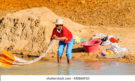 ANTANANARIVO, MADAGASCAR - JUNE 29, 2011: Unidentified Madagascar woman washes and cleans a sheet. People in Madagascar suffer of poverty due to the slow development of the country