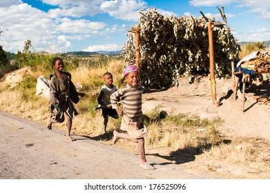ANTANANARIVO, MADAGASCAR - JUNE 30, 2011: Unidentified Madagascar children run in the street.  People in Madagascar suffer of poverty due to slow development of the country