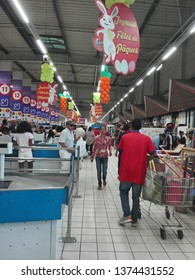 Antananarivo, Madagascar - March 14 2019 : Malagasy people shopping during the weekend before Easter at Jumbo Score. Scene near the cash desk. Jumbo Score is part of  Vindémia group.