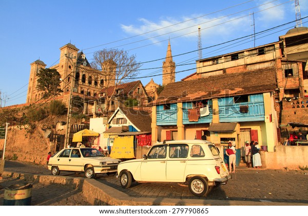 ANTANANARIVO, MADAGASCAR - SEPTEMBER 24, 2013: Urban scene at sunset with local people in the streets of Antananarivo, Madagascar, with the Royal Palace in the background on September 24, 2013