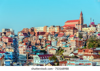 ANTANANARIVO MADAGASCAR-OCTOBER-17-2017:Buildings of a city with a street market of Antananarivo in sunny day. Madagascar
