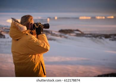 Antarctic Explorer Taking Pictures of Glacier