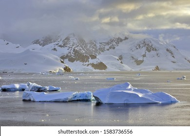 Antarctic icebergs illuminated by sunlight.