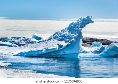 Antarctic icebergs and majestic landscape, sunny day,  blue sky