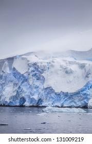 Antarctic icebergs with snowdrifts