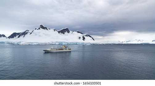 Antarctic- January 25, 2020- A discovery cruise ship bringing tourists makes its way past glaciers into Paradise bay in the antarctic peninsula .