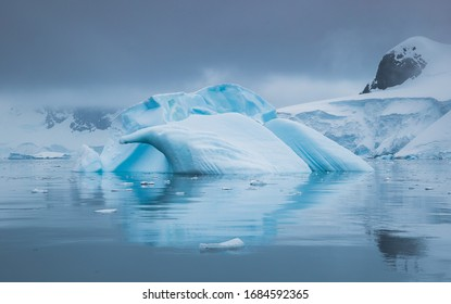 Antarctic landscape with glaciers, icebergs, mountains