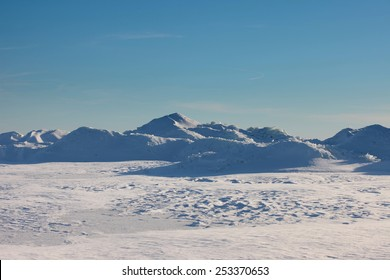 Antarctic landscape, ice and snow desert, snowy hills on a frozen plain