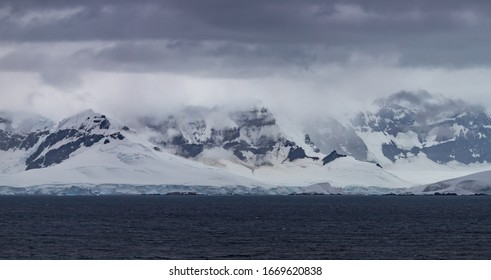 Antarctic landscape with mountains and glaciers