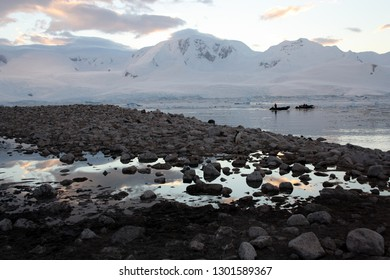 Antarctic landscape with zodiac boats