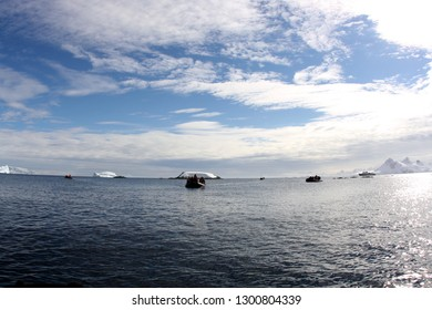 Antarctic landscape with zodiac boats and cruise hip
