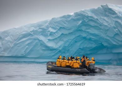 Antarctic Peninsula, Antarctica. 02.2020. People zodiac cruising in Antarctica with polar landscapes and ice.