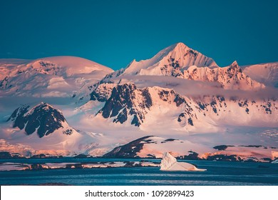 The Antarctic peninsula mountain range that was shot during the extreme expedition to the Vernadsky Research Base. The beauty of snow-covered mountain crest and Pacific Ocean.