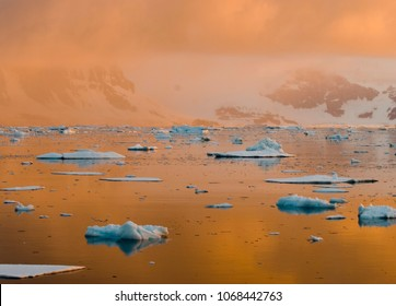 Antarctic sunset, with beautiful moody light diffused through the ice and air and water.  Best Sunset ever, on the Antarctic Peninsula, was the photo opportunity of a lifetime.