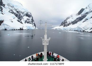 Antarctic tourist ship approaching a narrow passage