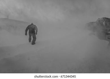 Antarctic Worker Walks Through Blizzard