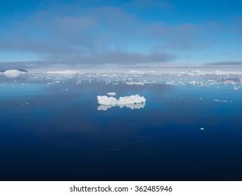 Antarctica blue iceberg landscape ocean mirror reflection
