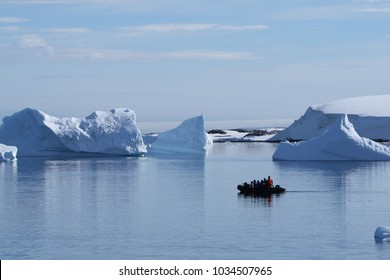 ANTARCTICA - CIRCA FEBRUARY 2009: Inflatable boat from an Antarctic cruise ship approaching the icebergs.
