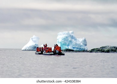 ANTARCTICA - CIRCA JANUARY 2015: Antarctica cruise passengers in an inflatable boat passing in front of icebergs