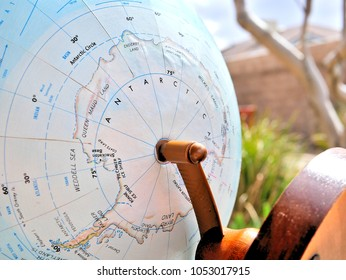 Antarctica isolated focus macro shot on globe map for travel blogs, social media, website banners and backgrounds.