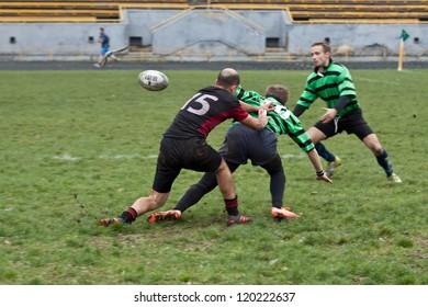 ANTARES - EGER, UKRAINE, KIEV- NOVEMBER 4 : Rugby players in action at a Ukrainian National Championship Final rugby match, Antares(in green) vs. Eger(in black), November 4, 2012 in Kiev, Ukraine.