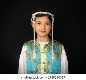 Antelope Valley, CA, USA, August 3, 2020: A young girl dressed in a Mongolian dell and headdress